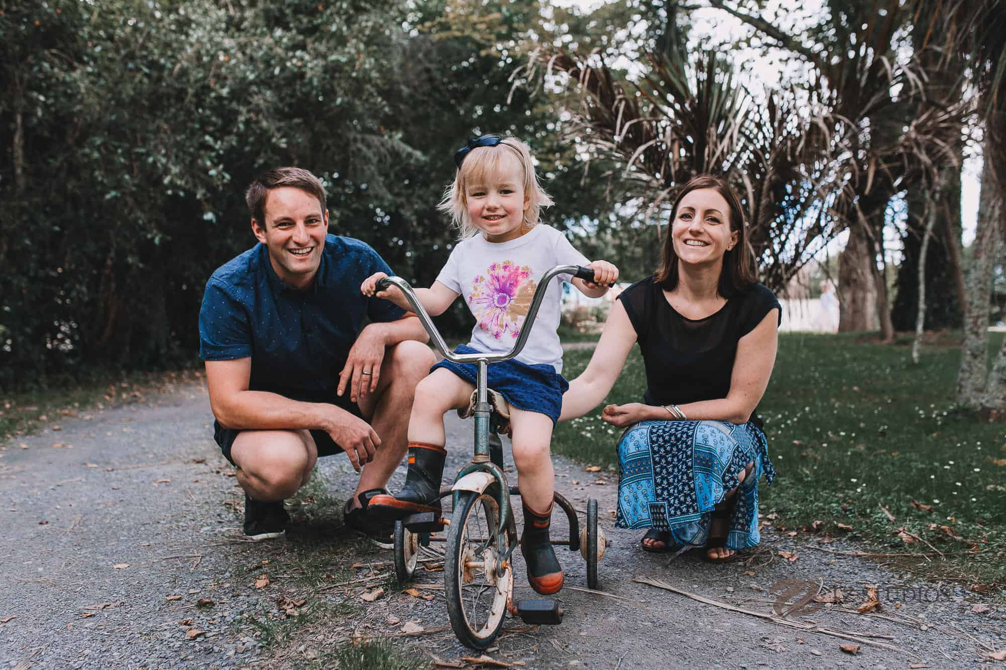 On her vintage push bike in this lifestyle Manawatu family portrait photoshoot
