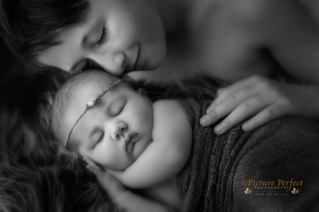 A brother and sister fine art black and white newborn portrait by Binh Trinh
